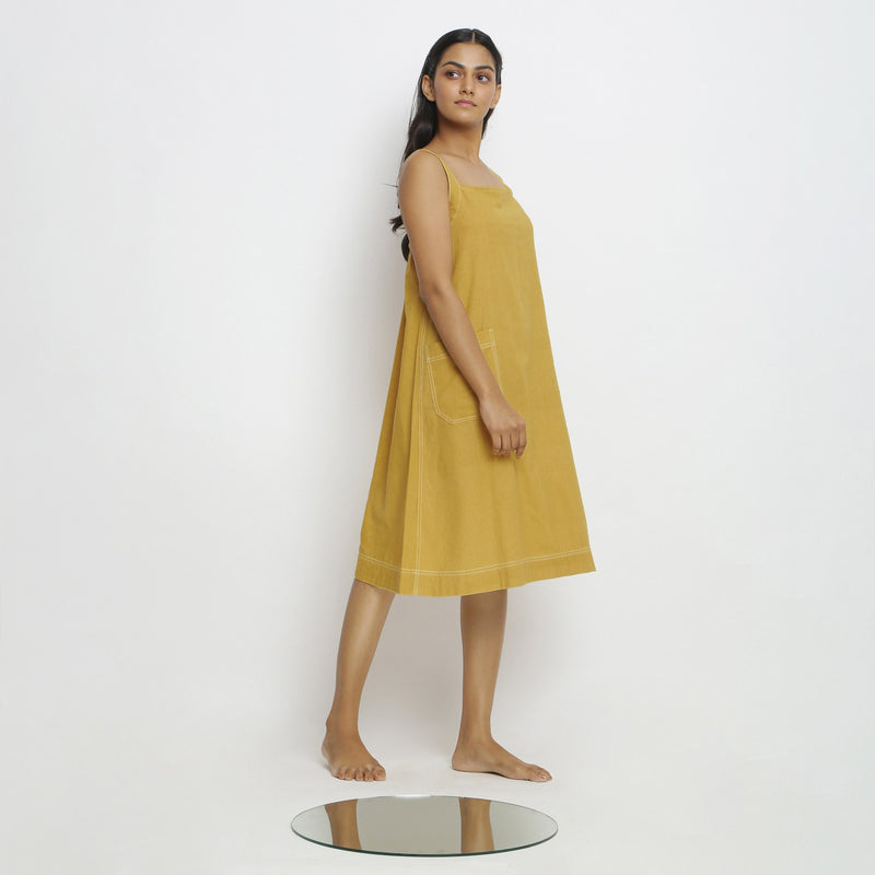 Right View of a Model wearing Yellow Vegetable Dyed Handspun Slip Dress