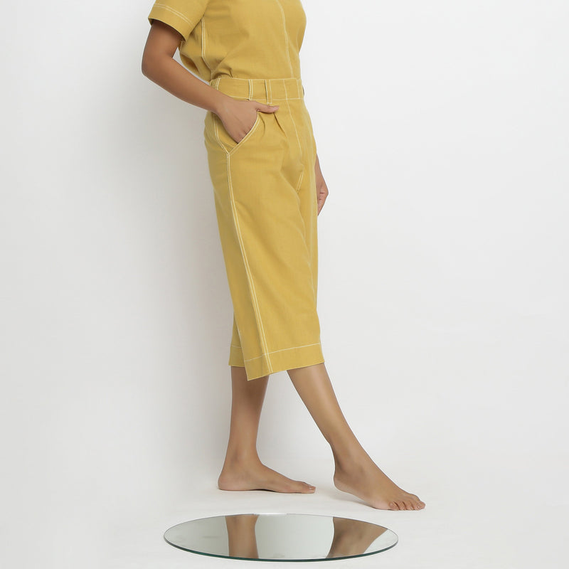 Right View of a Model wearing Yellow Mid Rise Vegetable Dyed Culottes
