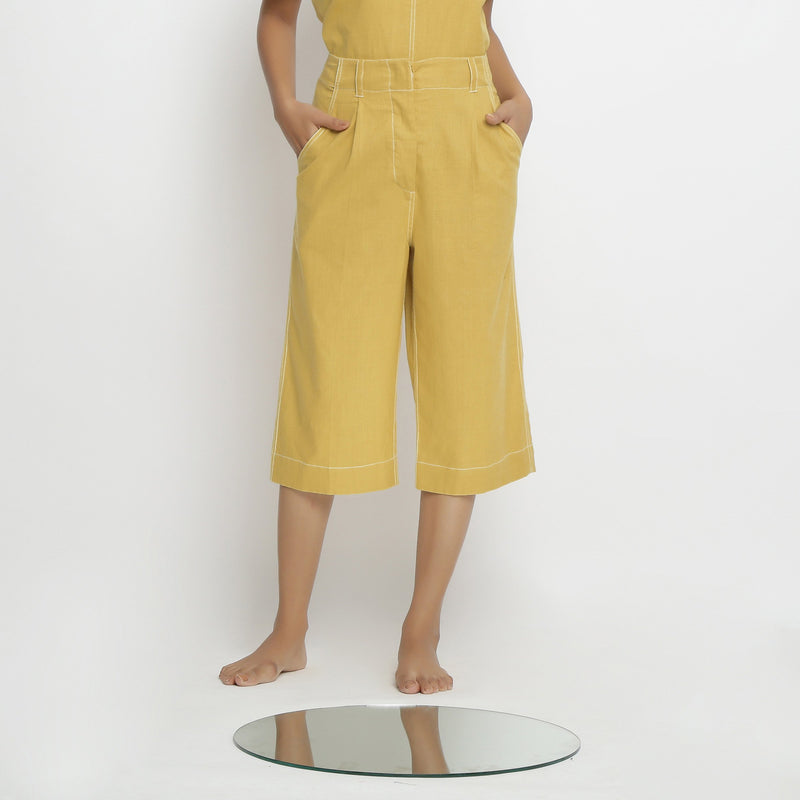 Front Detail of a Model wearing Yellow Mid Rise Vegetable Dyed Culottes
