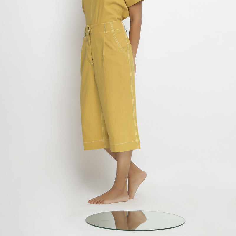 Left View of a Model wearing Yellow Mid Rise Vegetable Dyed Culottes