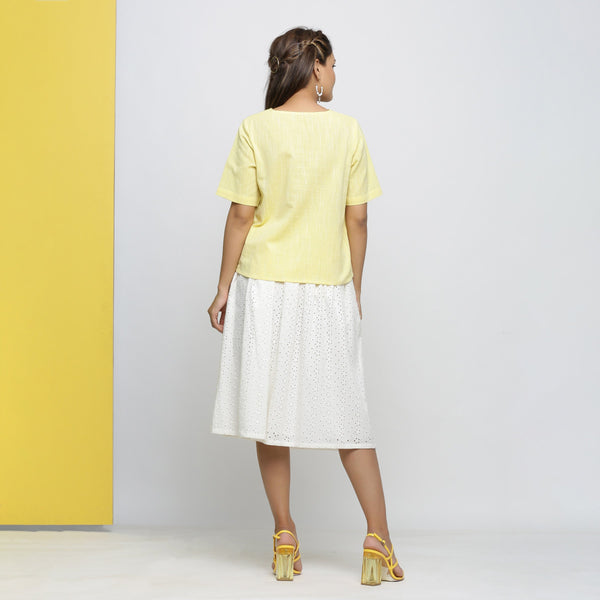 Back View of a Model wearing Yellow Yarn Dyed Cotton High Low Top