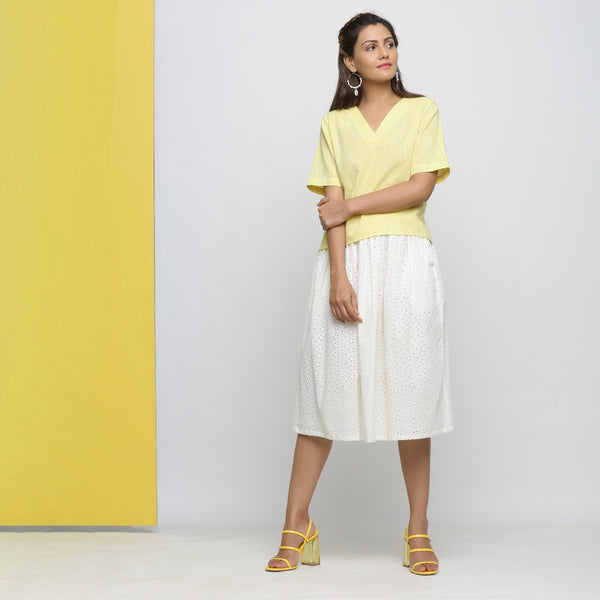 Front View of a Model wearing Yellow Yarn Dyed Cotton High Low Top