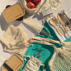 plastic-free pack with bags and cutlery and pegs on a table with a teal runner