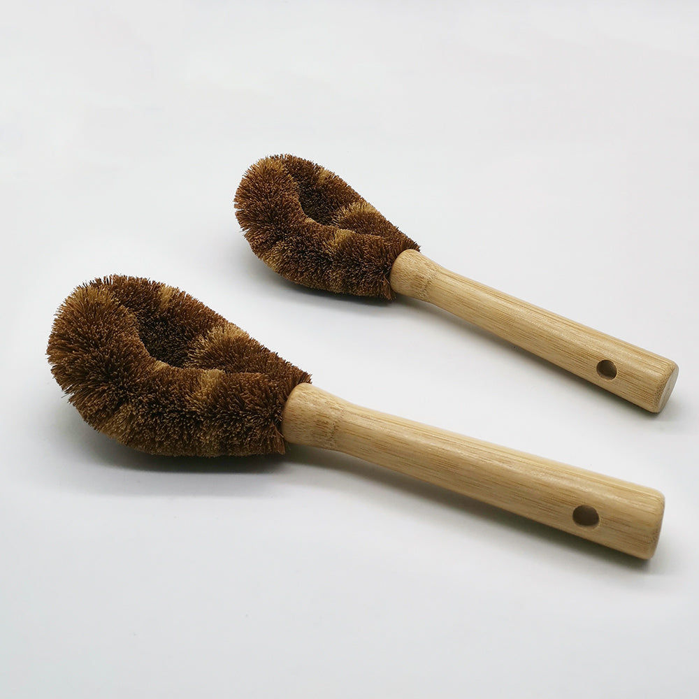two dishwashing brushes wooden on white