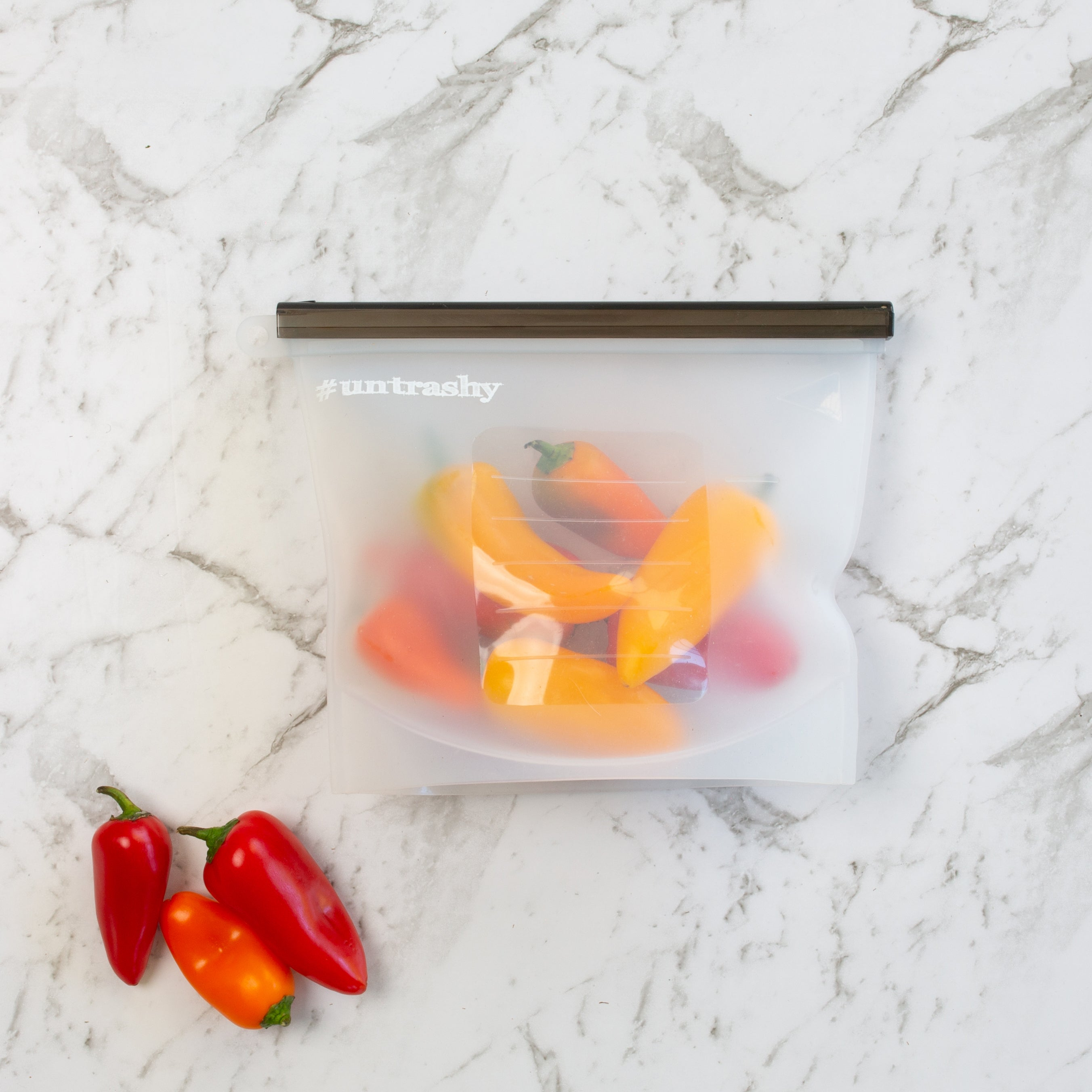 Silicone food pouch containing red and yellow chillis