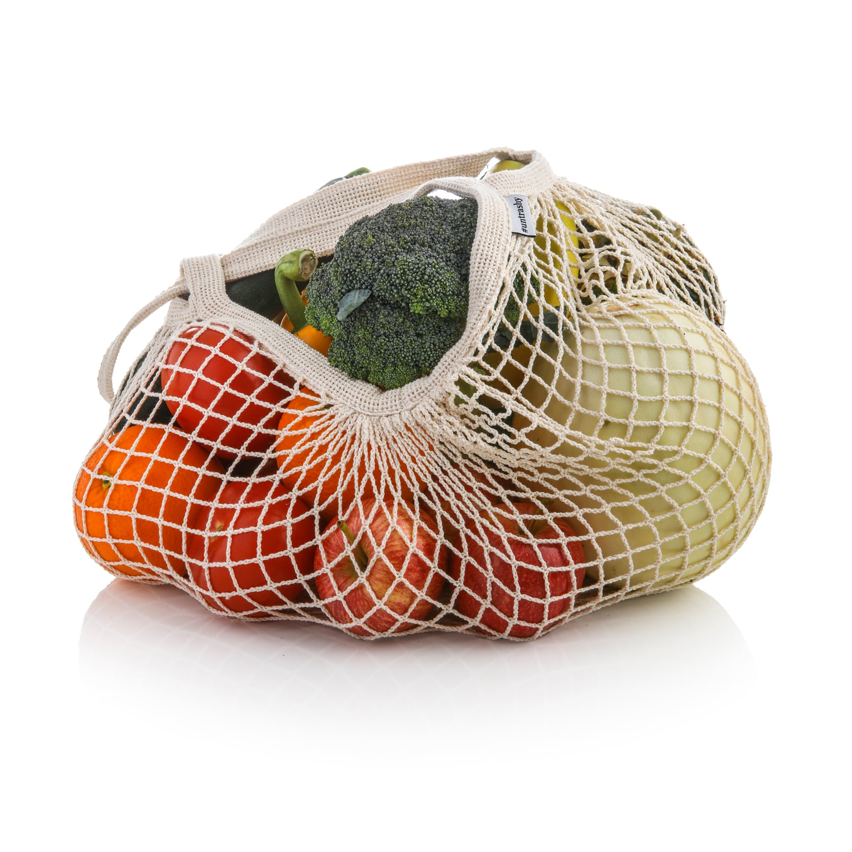 organic cotton string bag with fruit and vegetables