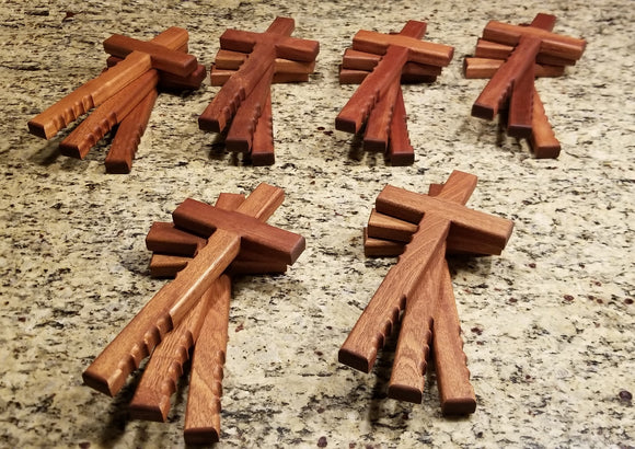 Powerful handheld Christian cross with finger grips.  The beautiful religious cross is 12