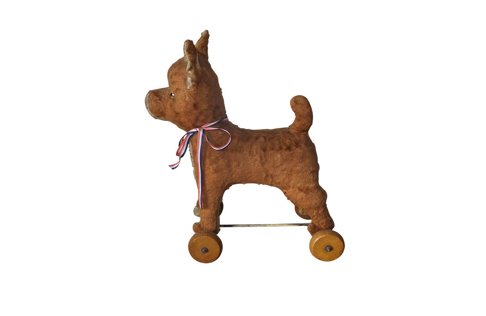 FRENCH ANTIQUE TOY DOG ON WHEELS