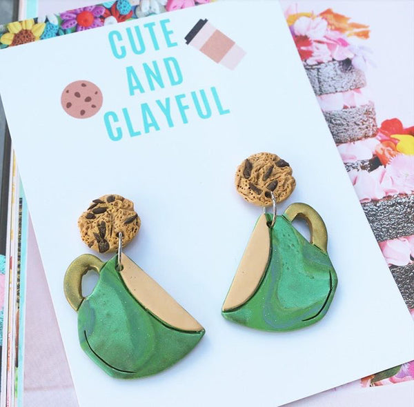 Whirly metallic green statement teacup dangles with cookies