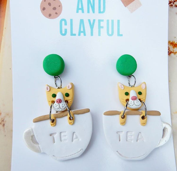 Cats in teacups - green stud top