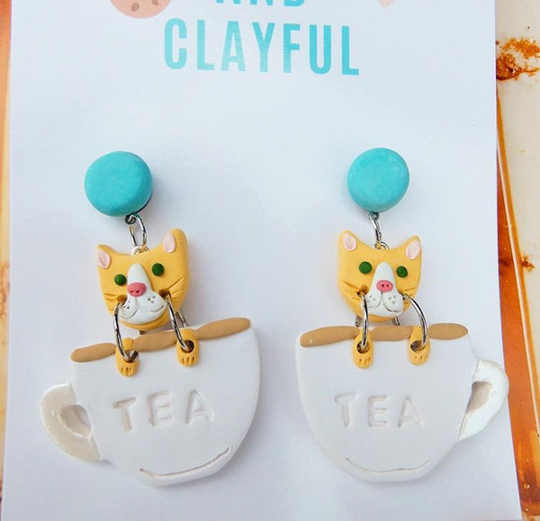 Cats in teacups - blue stud top