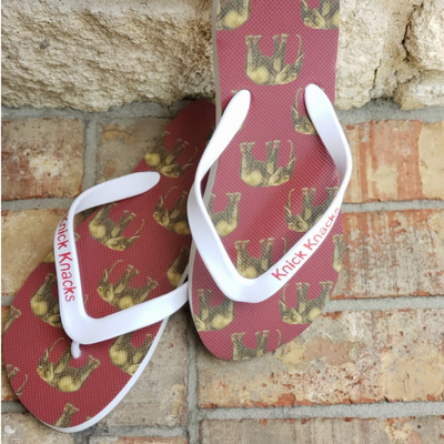 Elephant patterned flip flops