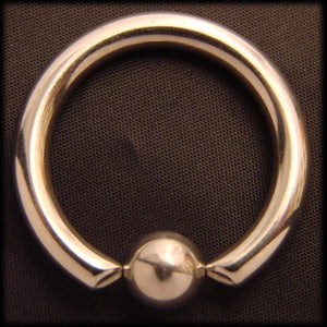 Piercing ring with account slave a surgical steel Another Way of Life