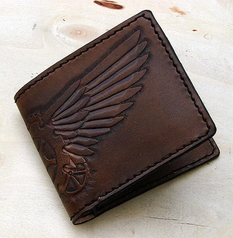 Hancrafted bifold wallet with steampunk wingsAnother Way of Life