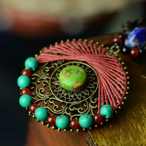 GREEN SUN PENDANT - deities