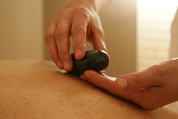 The Benefits of Hot Stone Massage for Fibromyalgia Patients