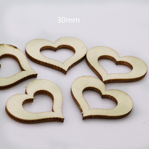 100pcs Wooden Christmas Tree Ornaments DIY Handmade Accessories Natural Wood Computer Laser Hollow Heart Wedding Decor