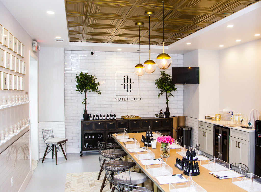 INDIEHOUSE modern fragrance bar workroom can host up  to 12 guests for custom scent blending experiences.