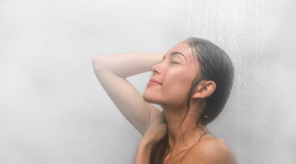 Asian woman taking a hot steaming shower