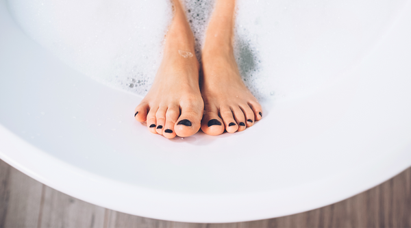 Womans feet in bathtub