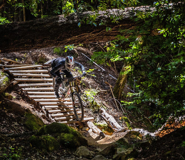 greg minnaar pro downhill rider on mountain bike park feature