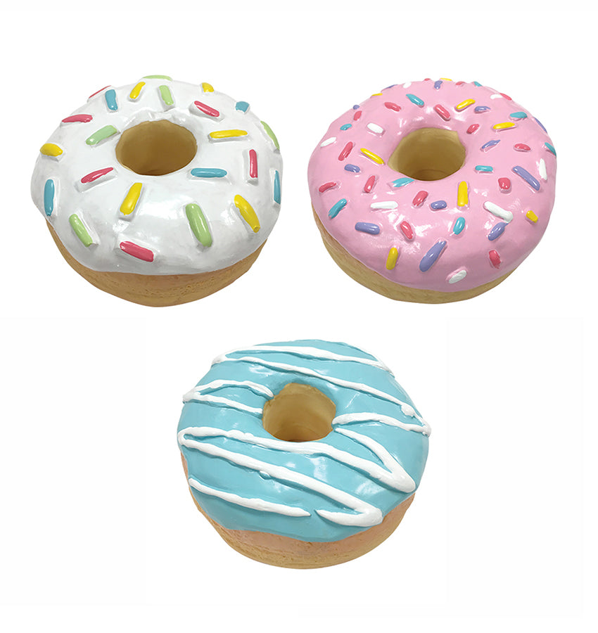 A group of the 3 donut chew toys that Little Chief and Co sells. Pink, Blue, and White.