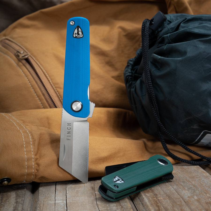 The Runtly - a unique pocket knife. Shown in blue and green