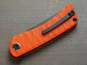 Orange folding knife with clip