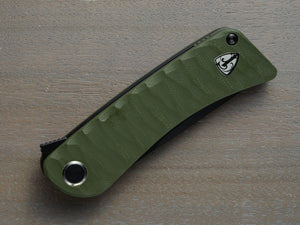 Green handled pocket knife with black blade