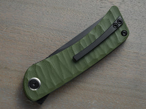 Folding knife with green handle and black blade
