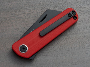 RUNTLY pocket knife with clip. Red handle and black blade. Folding knife in closed position.