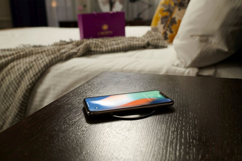 Qi Wireless charging - A phone charging on a Brandstand wireless charging solution.