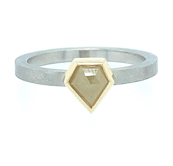White gold band  with the vibrant  7.5x 6.5mm elongated pentagonal (0.76ctw)yellow diamond.