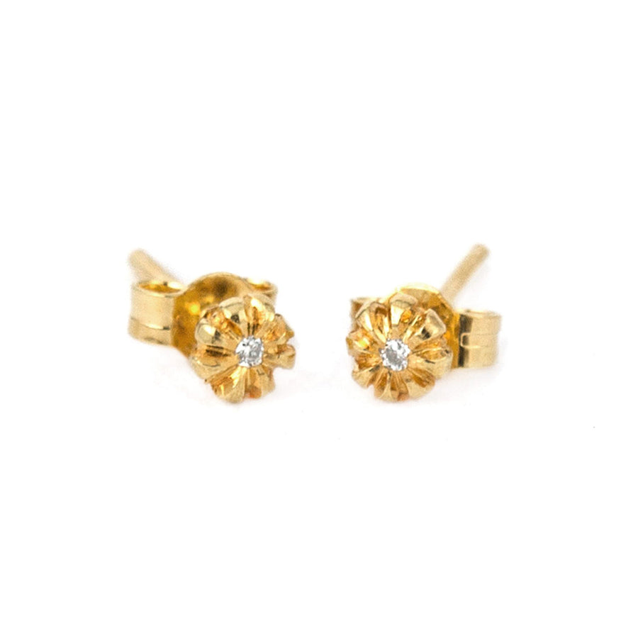 Dainty chrysanthemum bud earrings sits a sparkling diamond (1 mm).