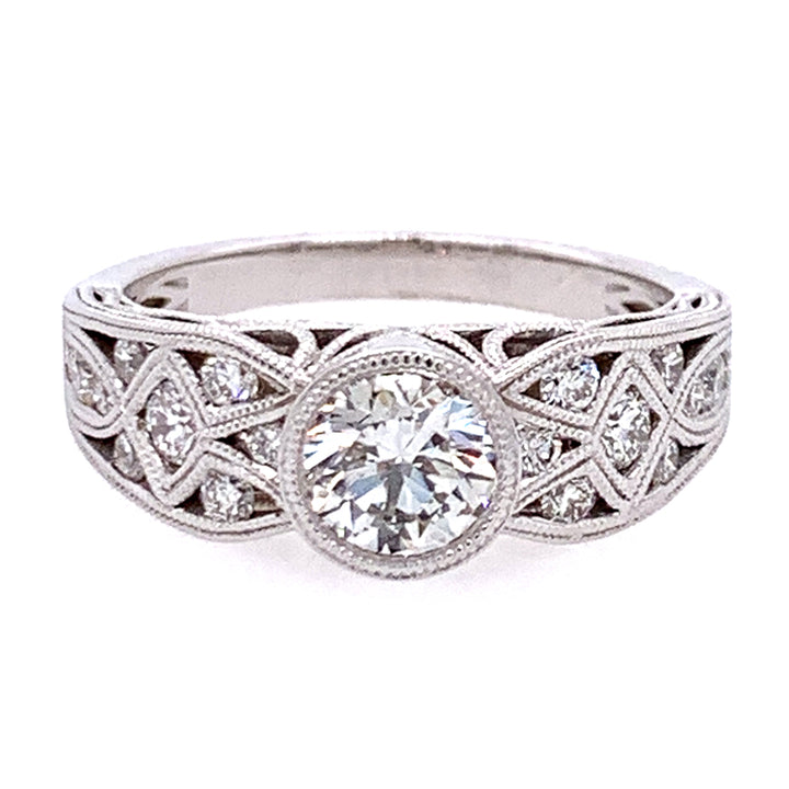Vintage inspired white gold engagement ring with milgrain detail