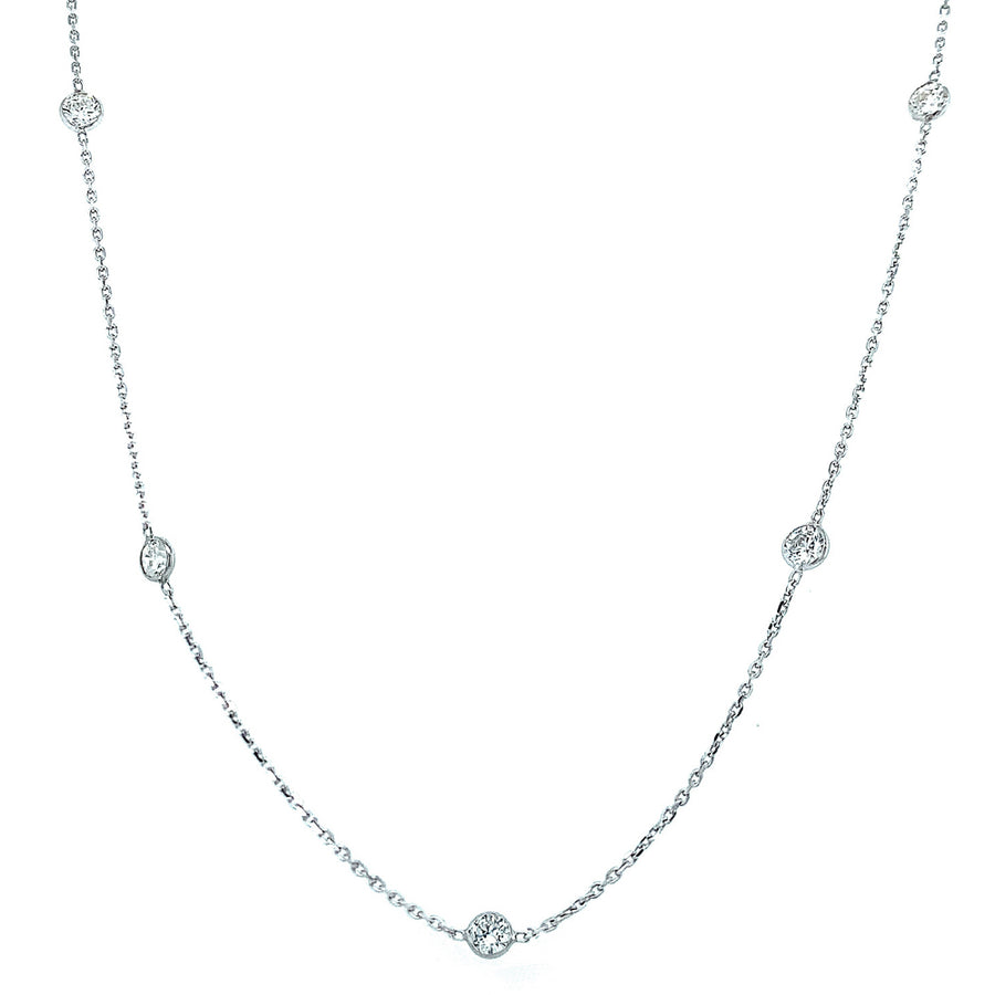 Elegant 14 karat white gold and diamond (1.30ctw) station necklace. Adorning five brilliant cut diamonds.