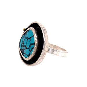 Teal and black hubei turquoise ring with yellow gold accent in sterling silver