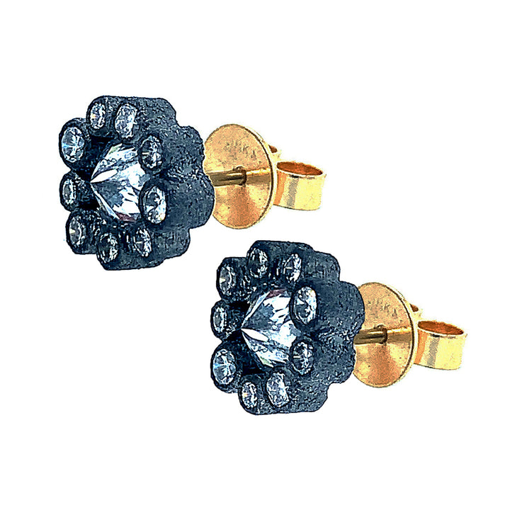Blackened 14 karat white gold  bezels set upon,18 karat yellow gold post. Studs are encrusted with inverted  brilliant round-cut (center) diamonds (1.11ctw), surrounded by a halo (0.70ctw) with nine brilliant-cut round diamonds.