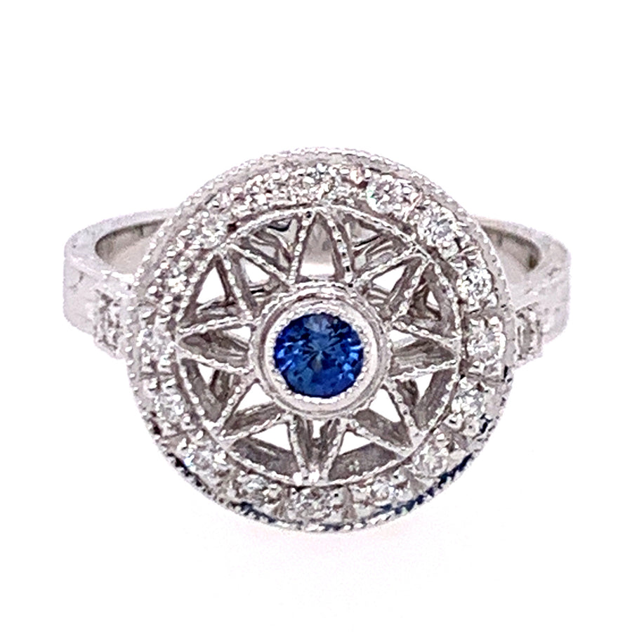 18 karat white gold ring: 3.2mm round Yogo sapphire + round brilliant-cut white diamonds (0.20ctw).
