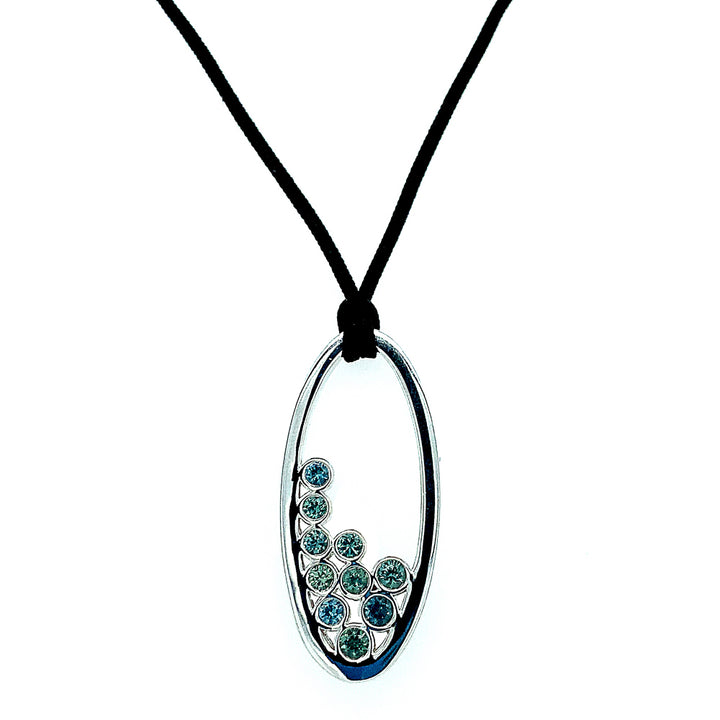 "Sterling silver set with light teal-blue  Montana sapphires, total gem (quantity 10 )weight is 1.03ctw. Pendant length, oval 1-1/2"" x 11/16"".  length: 30"" maximum silk lanyard, adjustable down to any length."