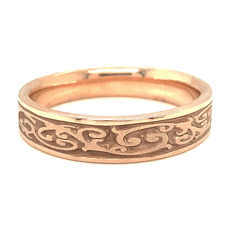 14 karat rose gold, 5.25 mm band that gradually tapers to a 4mm width.  Creeping vine design.
