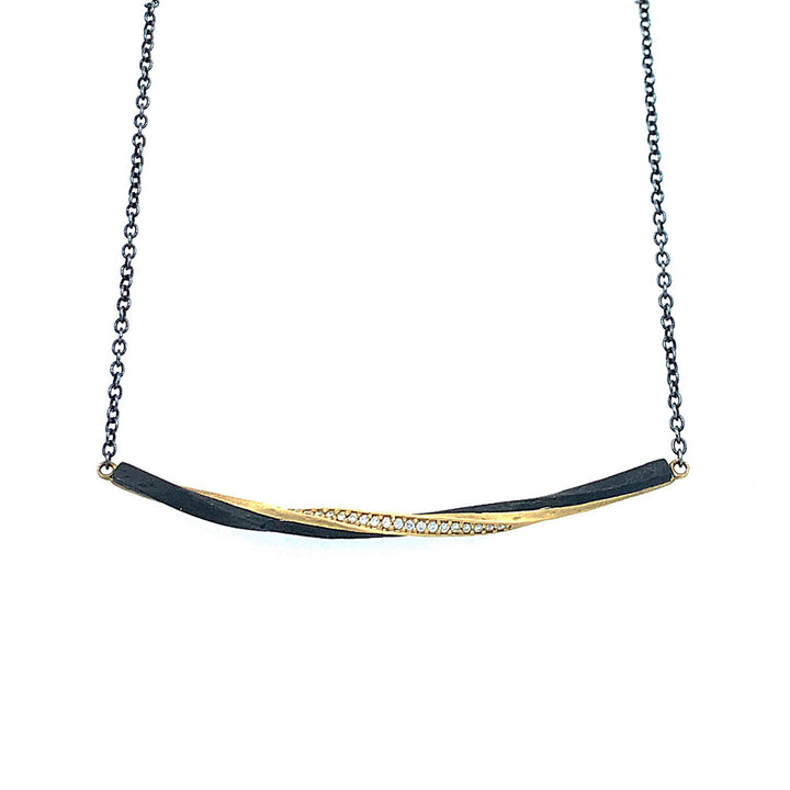 16 inch two-toned necklace, using oxidized cobalt chrome combined with 18 karat yellow gold. Adorned with a row of white diamonds (0.11ctw),  the pendant has a length of 2.25 inches set in an horizontal angle.