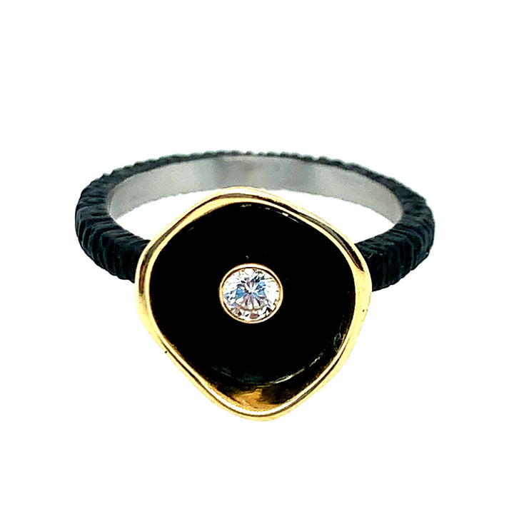 •	Size 6 ring, 18 karat yellow gold and oxidized cobalt chrome center gem: round brilliant-cut white diamond (0.10ct).