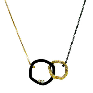 18 inch duo-toned necklace half cobalt chrome combined with  18 karat yellow gold. Two white round-cut diamonds (0.08ctw). Center piece is a pendant that reflects the duo-toned style.