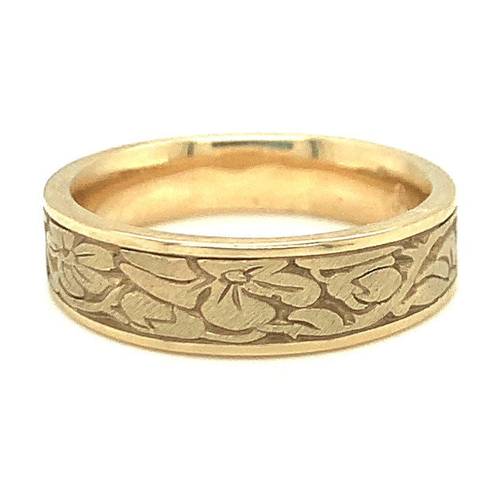 •	Cherry Blossoms 14 karat yellow gold band, bandwidth: 6mm.