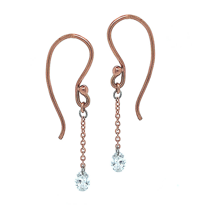 "14 karat rose gold drop earrings showcasing (0.33 ctw) oval diamonds (~3.2 mm x 5.2mm). The drop is 1 ¼"" , crafted with classic French hook ear wires."