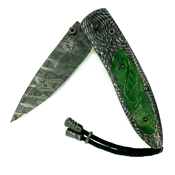 The Monarch B05 'Artemis' features a beautiful frame in hand-forged 'River Rock' Damascus by Chad Nichols, inlaid with carved green jade scales. The blade is hand-forged 'Hornets Nest' Damascus by Mike Norris.