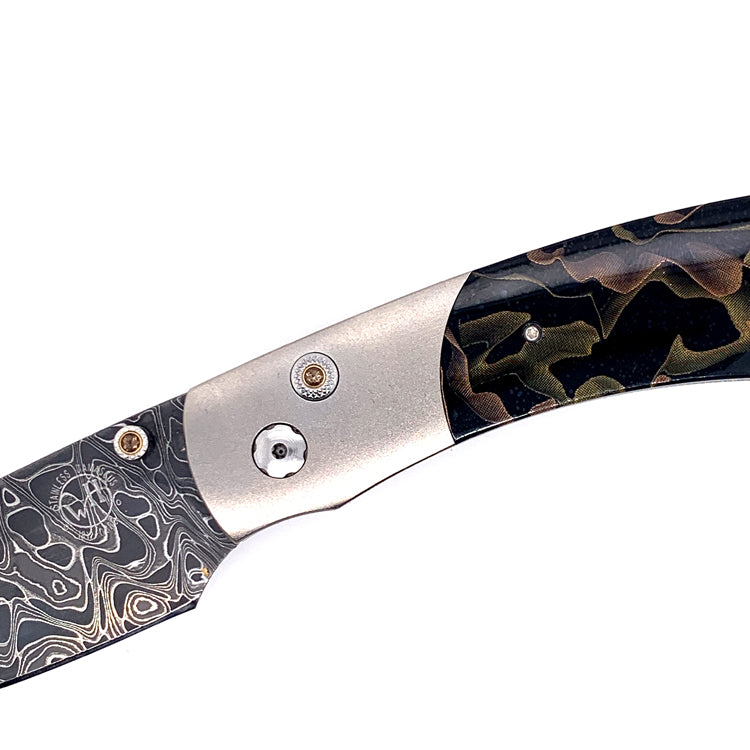 Damascus Steel and Titanium knife with topaz button detail by William Henry