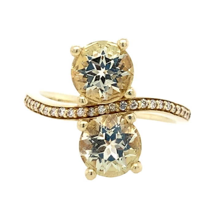 14 karat yellow gold ring, set with. gems: (2) - round brilliant-cut green beryls (2.44ctw) + brilliant-cut white diamonds (0.124ctw).