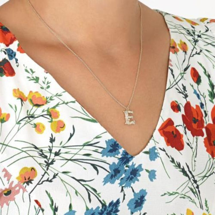 "Floral  capital ""E"" necklace by Alex Monro"